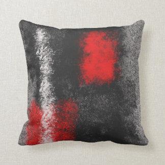 Coussin rouge et blanc gris-foncé abstrait