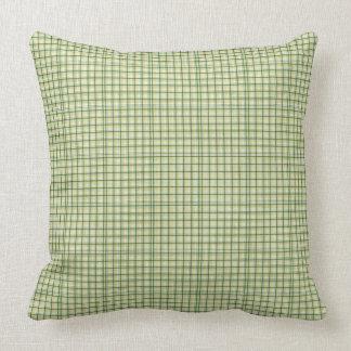 Coussin vert et jaune de motif de plaid