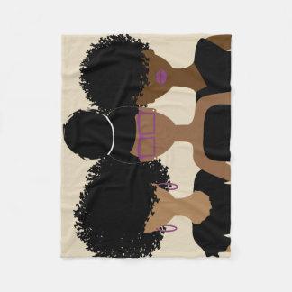 Couverture bouclée de trio de fille