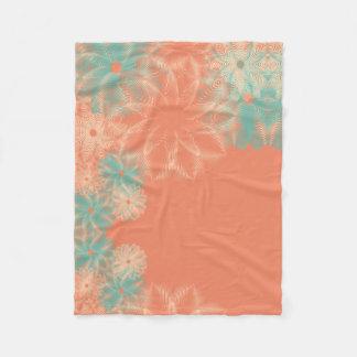 Couverture Polaire Corail et conception florale turquoise
