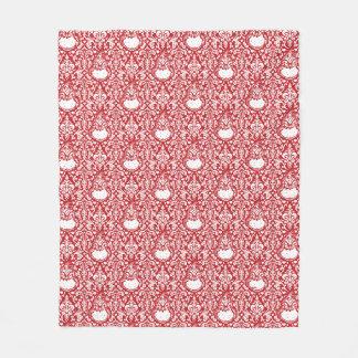 Couverture Polaire Le motif rouge de damassé de Grinch |