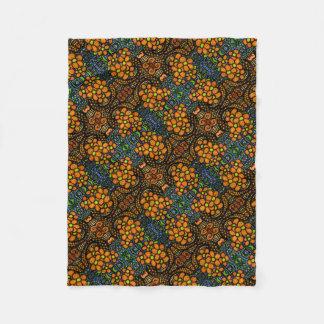 Couverture Polaire Motif floral orange lunatique