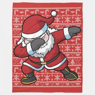 Couverture Polaire Noël tamponnant la limande du père noël