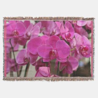 Couverture rose de jet d'orchidées