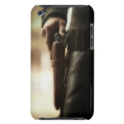 Cowboy avec l'arme à feu dans l'étui étuis iPod touch