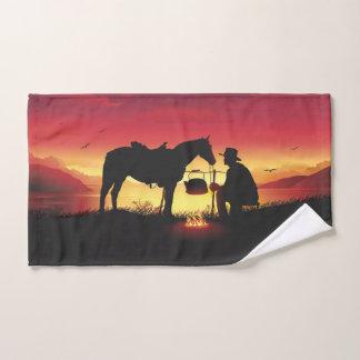 Cowboy et cheval à la serviette de main de coucher