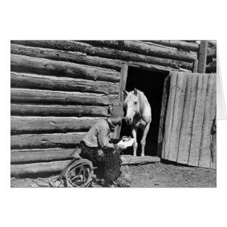 Cowboy et un cheval regardant une lettre carte de vœux