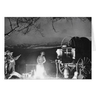 Cowboys jouant et chantant autour d'un feu de camp carte de vœux