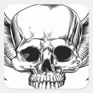 Crâne à ailes par faucheuse sticker carré