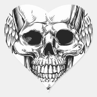Crâne à ailes par faucheuse sticker cœur