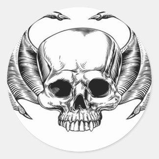 Crâne à ailes par faucheuse sticker rond