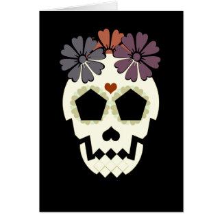 Crâne avec la carte de voeux de sépia de fleurs