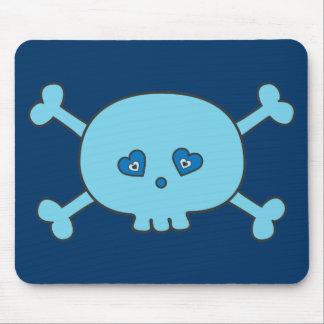 Crâne bleu mignon de bande dessinée tapis de souris