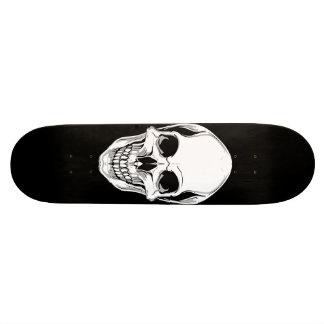 Crâne de grimacerie mauvais sur la planche à roule skateboards cutomisables