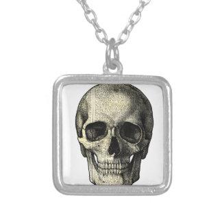 Crâne de journal pendentif carré