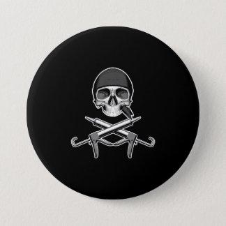 Crâne et pistolets à calfeutrer badge