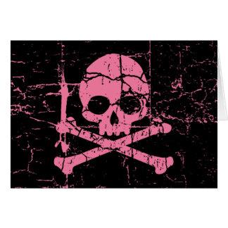 Crâne rose usé et os croisés carte de vœux