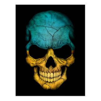 Crâne ukrainien de drapeau sur le noir carte postale