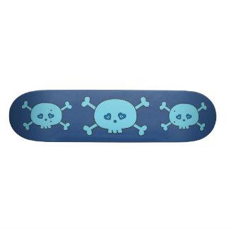 Crânes bleus géniaux de bande dessinée plateau de skate