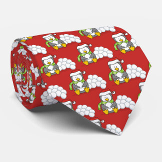 Cravates Pingouin de Noël se reposant avec des boules de