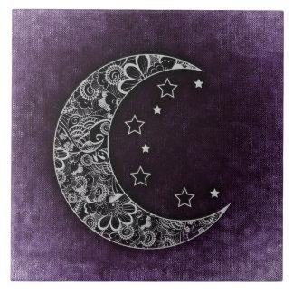Croissant de lune et étoiles floraux d'or sur le carreau