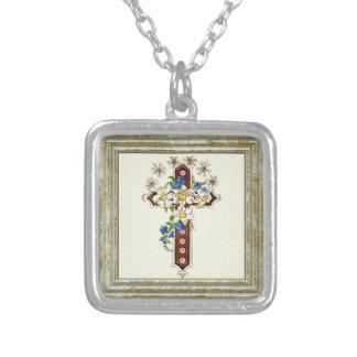 Croix chrétienne avec des fleurs collier