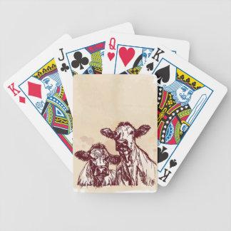 Croquis d'aspiration de main de deux vaches et cru cartes à jouer