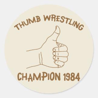 Cru 1984 de lutte de champion de pouce sticker rond