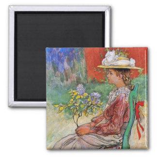Dagmar tenant des fleurs magnet carré