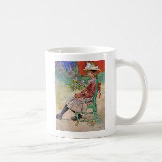 Dagmar tenant des fleurs mugs à café