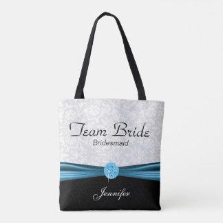 Damassé blanche et jeune mariée bleue d'équipe sac