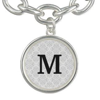 Damassé de monogramme bracelet avec breloques