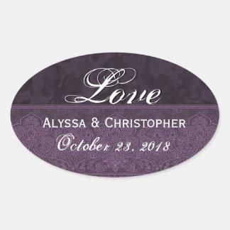 Damassé et ruban pourpres d'amour de mariage sticker ovale