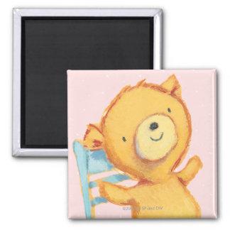 Danses et jeux jaunes d'ours sur la chaise aimant