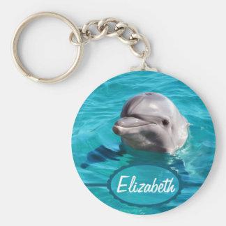 Dauphin en photo de l'eau bleue porte-clé rond
