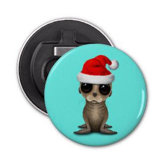 Décapsuleur Otarie de bébé utilisant un casquette de Père Noël