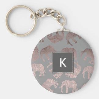 dégagez le motif tribal d'éléphant de feuille d'or porte-clé rond