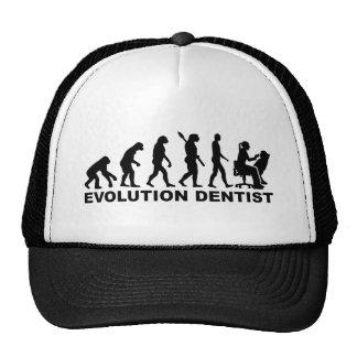 Dentiste de femelle d'évolution casquettes
