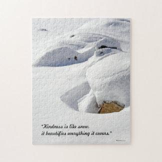 Dérives de neige au-dessus des roches puzzle avec photo