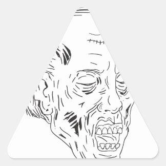 Dessin fermé de yeux principaux de zombi sticker triangulaire