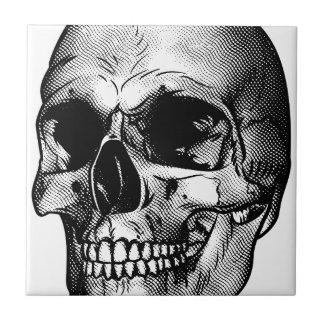 Dessin humain de crâne petit carreau carré