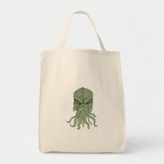 Dessin souterrain de tête de monstre de mer sacs