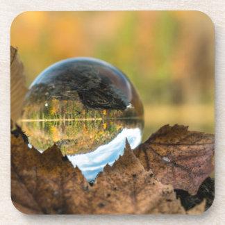 Dessous-de-verre Chute dans une boule