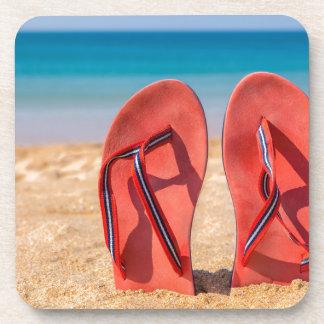 Dessous-de-verre Deux pantoufles rouges droites en sable de
