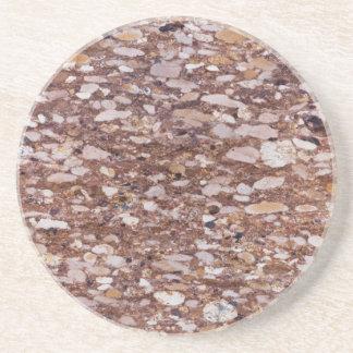 Dessous De Verre En Grès Surface d'un grès rouge avec les geods siliceux
