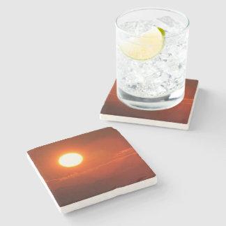 Dessous-de-verre En Pierre Source d'énergie de puissance de soleil de coucher