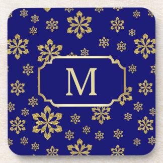 Dessous-de-verre Flocon de neige de monogramme d'or sur le bleu