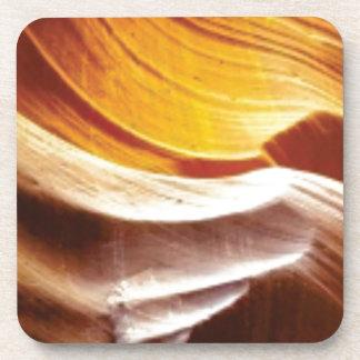 Dessous-de-verre roches bronzages du soleil d'orange