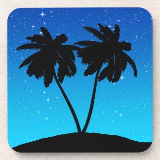 Dessous-de-verre Silhouette de palmier sur même le bleu avec des