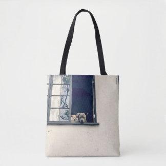 Deux chienchiens dans le sac fourre-tout à fenêtre